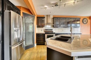 Photo 18: 143 Chapman Way SE in Calgary: Chaparral Detached for sale : MLS®# A1116023