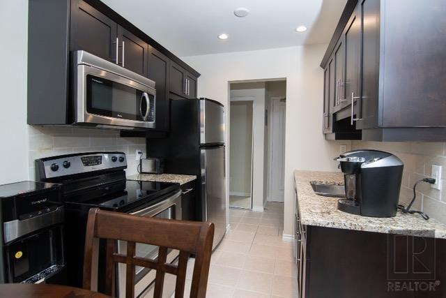 Photo 9: Photos: 306 1710 Taylor Avenue in Winnipeg: River Heights Condominium for sale (1D)  : MLS®# 1820539