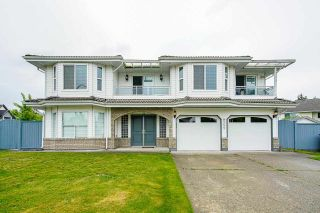 Photo 1: 9353 156A Street in Surrey: Fleetwood Tynehead House for sale : MLS®# R2575211