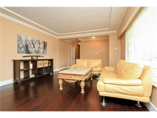 Photo 1: 752 SMITH AV in Coquitlam: Coquitlam West House for sale : MLS®# V1068510