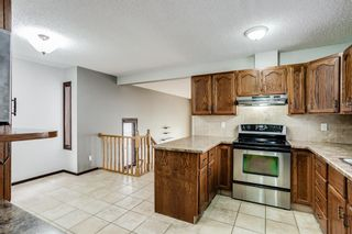 Photo 9: 219 Sandstone Drive NW in Calgary: Sandstone Valley Detached for sale : MLS®# A1112280