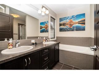 Photo 16: 63 RAVENSKIRK Heath SE: Airdrie House for sale : MLS®# C4027014