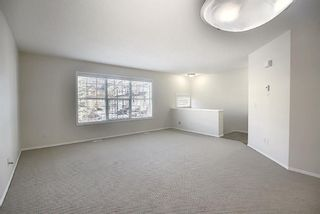 Photo 7: 25 Tuscany Springs Gardens NW in Calgary: Tuscany Row/Townhouse for sale : MLS®# A1053153
