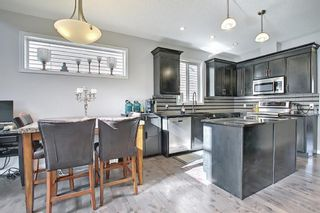 Photo 4: 19 AUTUMN View SE in Calgary: Auburn Bay Detached for sale : MLS®# A1076739