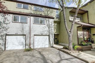 Photo 2: 104 2423 56 Street NE in Calgary: Pineridge Row/Townhouse for sale : MLS®# A1114587