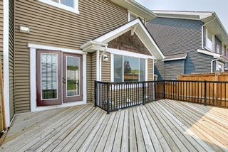 Photo 48: 566 River Heights Crescent: Cochrane Semi Detached for sale : MLS®# A1129968