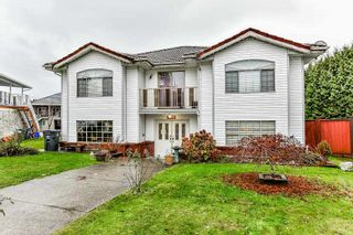 Photo 1: 7010 143A Street in Surrey: East Newton House for sale : MLS®# R2324201