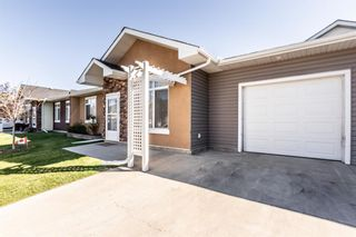 Photo 1: 305 Sunvale Crescent NE: High River Row/Townhouse for sale : MLS®# A1144470