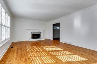 Photo 6: 7311 11 Street SW in Calgary: Kelvin Grove Detached for sale : MLS®# A1049038
