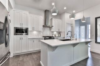 Photo 1: 20451 83B AVENUE in Langley: Willoughby Heights House for sale : MLS®# R2572124