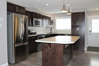 Photo 13: 1404 Clover Link: Carstairs Row/Townhouse for sale : MLS®# A1073804