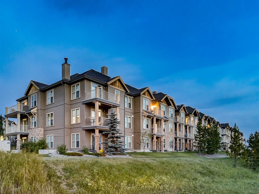 Main Photo: 213 207 SUNSET Drive: Cochrane Apartment for sale : MLS®# A1026900