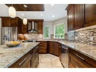 """Photo 12: 10486 SUMAC Place in Surrey: Fraser Heights House for sale in """"Glenwood Estates"""" (North Surrey)  : MLS®# R2579473"""