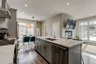 Photo 1: 1702 19 Avenue SW in Calgary: Bankview Row/Townhouse for sale : MLS®# A1078648