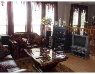 Photo 2: 2323 HAVERSLEY AV in Coquitlam: Coquitlam East House for sale : MLS®# V581981