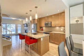 Photo 15: 206 20 Brentwood Common NW in Calgary: Brentwood Row/Townhouse for sale : MLS®# A1094821