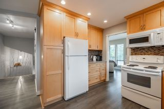 Photo 10: 15027 SPENSER Drive in Surrey: Bear Creek Green Timbers House for sale : MLS®# R2625533