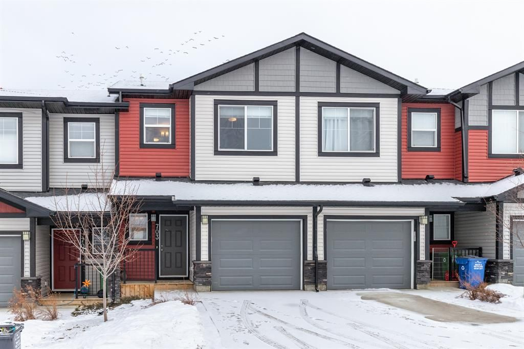 Main Photo: 703 Jumping Pound Common: Cochrane Row/Townhouse for sale : MLS®# A1064956