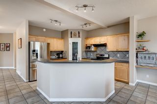 Photo 4: 250 Elmont Bay SW in Calgary: Springbank Hill Detached for sale : MLS®# A1119253