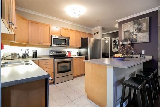 """Photo 9: Photos: 401 808 SANGSTER Place in New Westminster: The Heights NW Condo for sale in """"THE BROCTON"""" : MLS®# R2215829"""