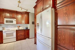 Photo 4: 2716 LOUGHEED Drive SW in Calgary: Lakeview Detached for sale : MLS®# A1032404