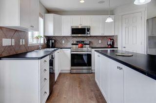Photo 4: 26 Gleneagles Terrace: Cochrane Detached for sale : MLS®# A1130075