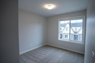 Photo 18: 1601 250 fireside Drive: Cochrane Row/Townhouse for sale : MLS®# A1143826