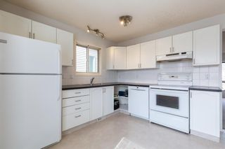 Photo 4: 887 Erin Woods Drive SE in Calgary: Erin Woods Detached for sale : MLS®# A1099055