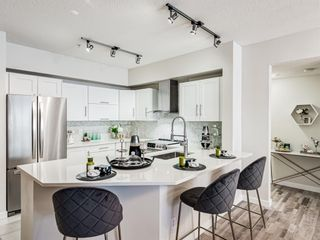 Photo 1: 213 838 19 Avenue SW in Calgary: Lower Mount Royal Apartment for sale : MLS®# A1114629