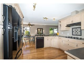 """Photo 9: 6155 131 Street in Surrey: Panorama Ridge House for sale in """"PANORAMA PARK"""" : MLS®# R2556779"""