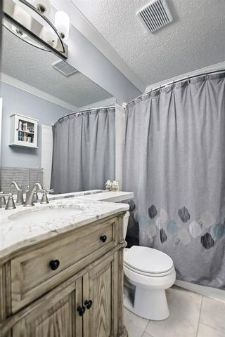 Photo 25: 56 Woodside Road NW: Airdrie Detached for sale : MLS®# A1144162