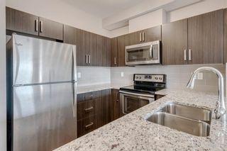 Photo 3: 210 200 Cranfield Common SE in Calgary: Cranston Apartment for sale : MLS®# A1094914