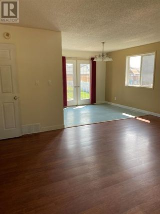Photo 3: 10601 106 Street in High Level: House for sale : MLS®# A1148507