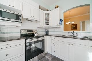 """Photo 14: 215 3098 GUILDFORD Way in Coquitlam: North Coquitlam Condo for sale in """"Marlborough House"""" : MLS®# R2555824"""