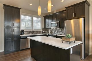 Photo 6: 22 Nolan Hill Heights NW in Calgary: Nolan Hill Row/Townhouse for sale : MLS®# A1101368