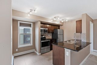 Photo 6: 7411 403 Mackenzie Way SW: Airdrie Apartment for sale : MLS®# A1152134