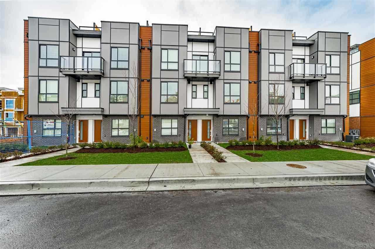 """Main Photo: 31 19760 55 Avenue in Langley: Langley City Townhouse for sale in """"TERRACES 3"""" : MLS®# R2590652"""