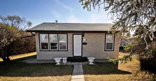 Photo 1: 1916 Home Road NW in Calgary: Montgomery House for sale