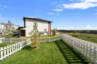 Photo 28: 1404 Jumping Pound Common: Cochrane Row/Townhouse for sale : MLS®# A1146897