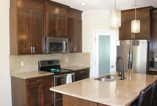 Photo 12: 734 Ranch Crescent: Carstairs Detached for sale : MLS®# C4291819