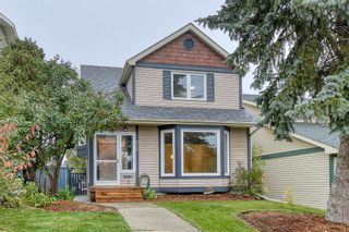Photo 1: 215 Strathearn Crescent SW in Calgary: Strathcona Park Detached for sale : MLS®# A1146284