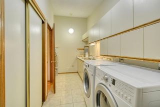 Photo 33: 20A Woodmeadow Close SW in Calgary: Woodlands Row/Townhouse for sale : MLS®# A1127050