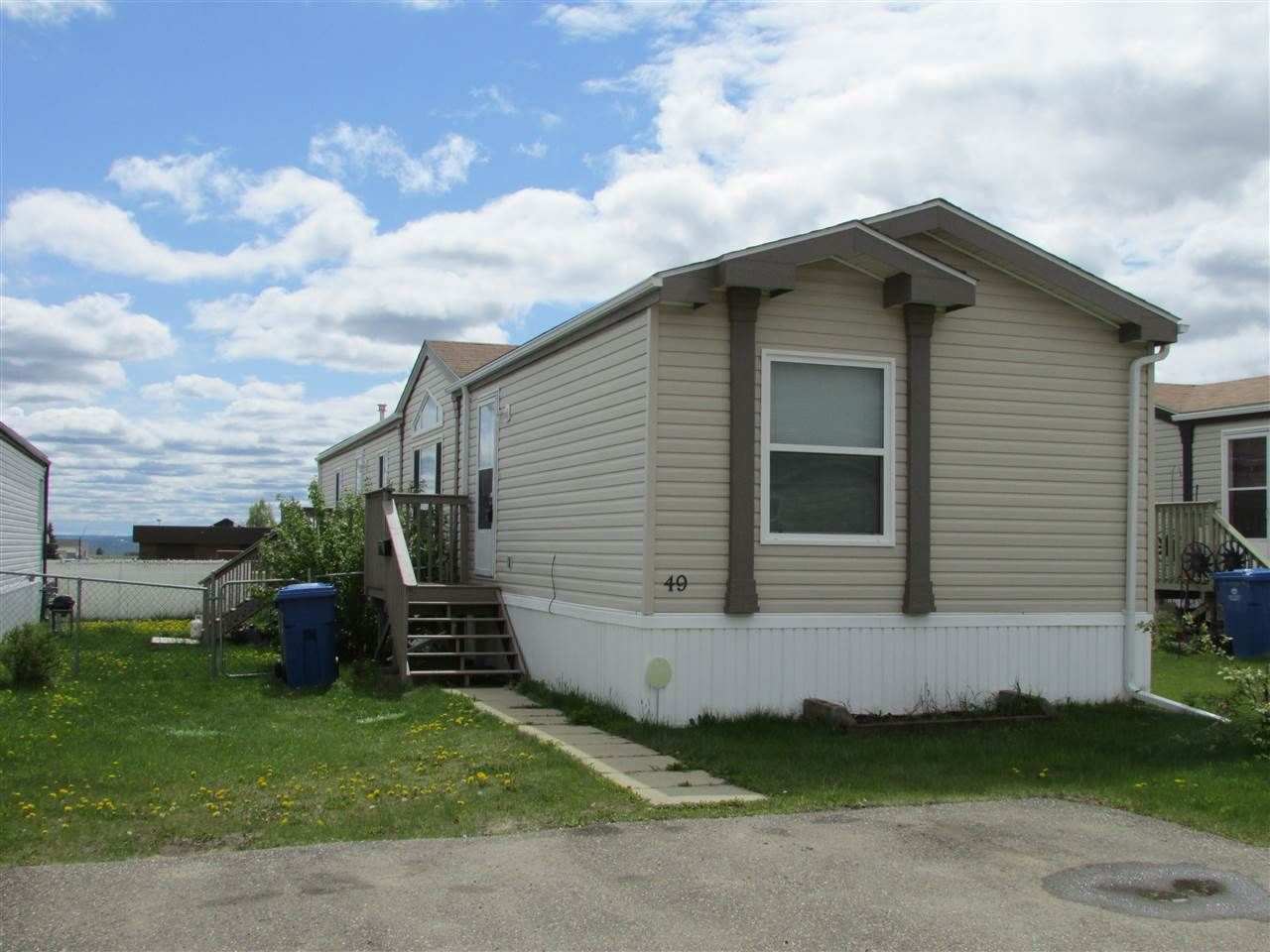 """Main Photo: 49 9203 82 Street in Fort St. John: Fort St. John - City SE Manufactured Home for sale in """"THE COURTYARD"""" (Fort St. John (Zone 60))  : MLS®# R2074488"""
