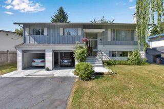 Photo 1: 14247 103 Avenue in Surrey: Bear Creek Green Timbers House for sale : MLS®# R2595782