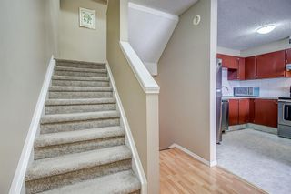 Photo 8: 1309 Ranchlands Road NW in Calgary: Ranchlands Row/Townhouse for sale : MLS®# A1060522