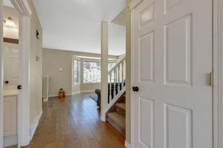 Photo 8: 322 Arbour Grove Close NW in Calgary: Arbour Lake Detached for sale : MLS®# A1115471
