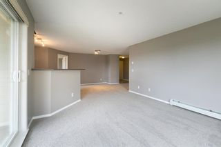 Photo 11: 8329 304 MACKENZIE Way SW: Airdrie Apartment for sale : MLS®# A1128736