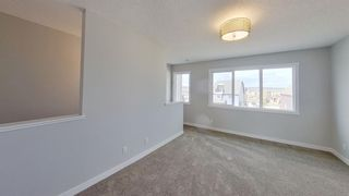 Photo 12: 167 Lucas Boulevard NW in Calgary: Livingston Row/Townhouse for sale : MLS®# A1142913