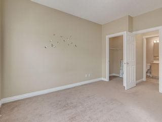 Photo 23: 81 Somme Boulevard SW in Calgary: Garrison Woods Residential for sale : MLS®# A1072185
