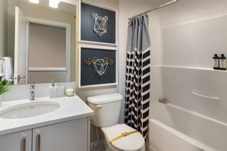 Photo 9: 641 Cranbrook Walk SE in Calgary: Cranston Row/Townhouse for sale : MLS®# A1129730